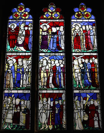 Picture of stained glass. Nine panels, each showing a group of angels.